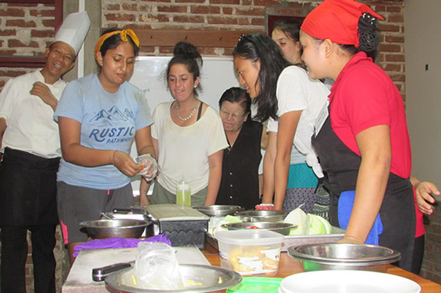 Students from the USA taking a turn to practice kitchen skills